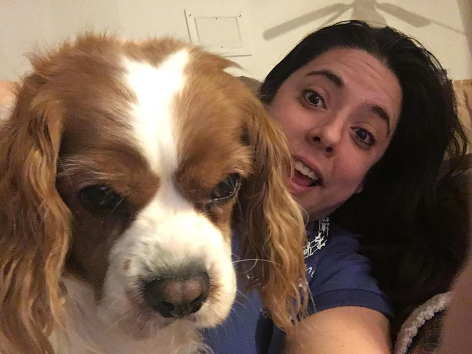 Ms. Casiano goofing off with her favorite fur baby